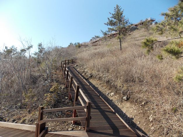 Natural trail, or newly finished stairs/ramp combo will help get you to the top.
